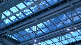 Airport terminal roof reflect people trafic. Still and Glass. People with bags departures and arrivals. Airport terminal roof reflect people trafic. Still and stock video footage