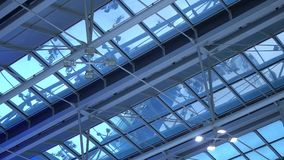 Airport terminal roof reflect people trafic. Still and Glass. People with bags departures and arrivals. Airport terminal roof reflect people trafic. Still and stock footage