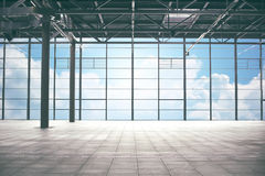 Airport terminal room over blue sky and clouds Stock Photos