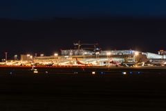Airport Terminal of Stuttgart (Germany) at dusk. STUTTGART, GERMANY - MAY 6, 2014: Stuttgart Airport at dusk with planes departing and arriving as seen from over Stock Photo