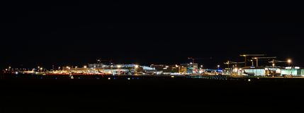 Airport Terminal of Stuttgart (Germany) - wide angle shot. STUTTGART, GERMANY - MAY 6, 2014: Wide angle shot of Stuttgart Airport at dusk with planes departing Stock Photography