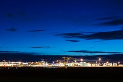 Airport Terminal of Stuttgart (Germany) - wide angle shot. STUTTGART, GERMANY - MAY 6, 2014: Wide angle shot of Stuttgart Airport at dusk with planes departing Royalty Free Stock Images