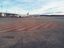Airport terminal. View of an airport terminal Tarmac with planes Stock Images