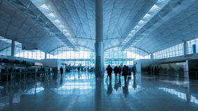 Airport Timelapse. 4k timelapse video of commuters in an airport. Cool tone, zoom in shot stock footage