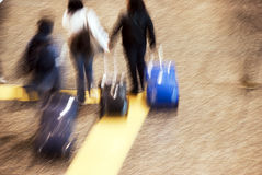 Airport tourists in movement. Abstract crowd in a rush hour in the airport - tourists and workers running to the gate royalty free stock photo