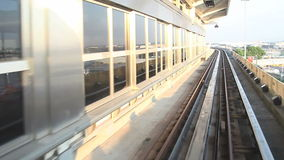 Airport Tram Ride. Tram / train ride between stations at the airport. shot coming into the station between terminals stock footage