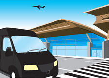 Airport transfer. A taxi pulling up next to the airport terminal Stock Image