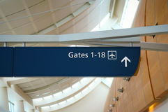Airport travel. Gates 1-18 are this way. Airport sign at San Jose International airport royalty free stock image