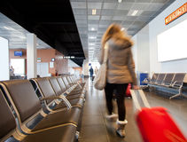 Airport traveler. Traveler in airport scene, people carrying luggage to departure gate preparing to travel by plane Stock Images