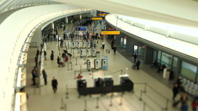 Airport Travelers Check-in Area Tilt Shift. V22. Airport travelers at checkin area using a tilt shift lens stock footage