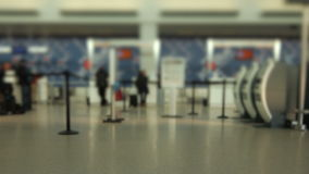 Airport Travelers Check-in Area Tilt Shift. V25. Airport travelers at checkin area using a tilt shift lens stock video