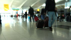 Airport Travelers Check-in Area Tilt Shift. V27. Travelers walking by and waiting in line at checkin area