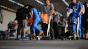 Airport travelers defocused. At Don Muang airport stock footage