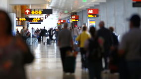 Airport Travelers People. V17. Clip of airport travelers walking by and down hallway in airport. Focus on background stock footage