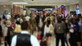 Airport Travelers People. V32. Airport travelers walking by and down hallway in airport. Focus on background stock video