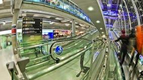 Airport Travelers Time Lapse Bangkok Fisheye. V21. Airport travelers time lapse clip using a fisheye lens stock video footage