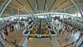 Airport Travelers Time Lapse Fisheye. V14. Airport travelers time lapse clip using a fisheye lens. Slight circular blur stock footage