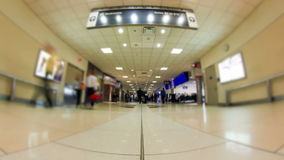 Airport Travelers Time Lapse. V16. Low angle time lapse of airport travelers going by stock footage