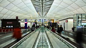 Airport Travelers Time Lapse. V15. Time lapse of airport travelers on moving walkway stock video footage