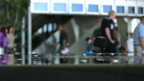 Airport Travelers. V34. Airport travelers with fountain in foreground stock video footage