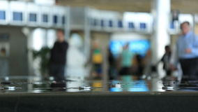 Airport Travelers. V35. Airport travelers with fountain in foreground stock video