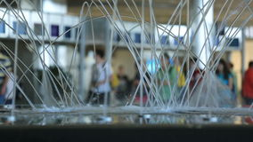 Airport Travelers. V36. Airport travelers with fountain in foreground stock video footage