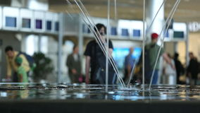Airport Travelers. V37. Airport travelers with fountain in foreground stock footage