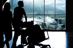 Airport traveller. Traveller on airport pushing trolley Royalty Free Stock Photography