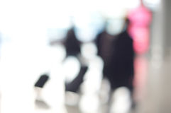Airport Travellers walking with luggage Abstract Royalty Free Stock Photo