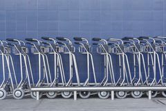 Airport trolley parking lot with empty trolleys and blue wall Stock Photography