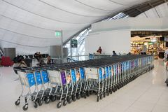 Airport trolley parking lot with empty trolleys waiting use service Stock Photography