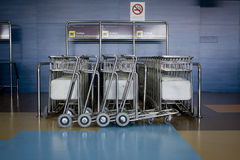 Airport Trolley Stack. Stack of trolleys at an airport arrival lounge Royalty Free Stock Images
