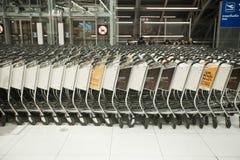 Airport trolleys. BANGKOK – JANUARY 17. Stacked empty trolleys in early morning Bangkok airport on January 17, 2012. Suvarnabhumi airport is world's 4th Royalty Free Stock Photos