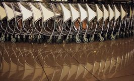 Airport trolleys. View of trolleys in a row reflected in the floor stock photography