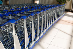 Airport trolleys. Trolleys in a row,at airport Royalty Free Stock Photos