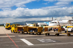 Airport trucks handling baggage at Zagreb Airport Royalty Free Stock Image