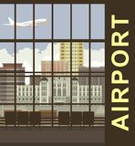 Airport views. Large windows Airport several chairs a nice view on the city buildings in the sky flying aircraft Stock Photos