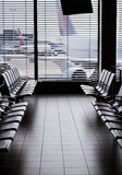 Airport waiting area. Airport departure waiting area with empty seats and aircraft outside Royalty Free Stock Photo