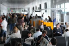 Airport waiting area. A blurred view of a crowded airport waiting area or gate stock photo