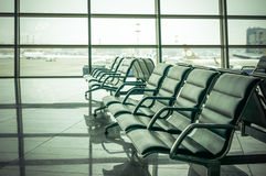 Airport waiting area , seats and outside the window scene Royalty Free Stock Photos