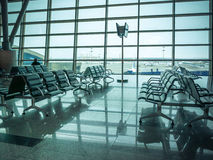Airport waiting area , seats and outside the window scene Royalty Free Stock Photography