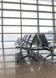 Airport waiting area, seats and outside the window Royalty Free Stock Images