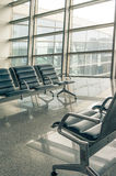 Airport waiting area seats and window Stock Image