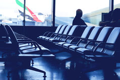 Airport waiting lounge. Scene with people waiting to embark royalty free stock image