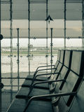 Airport waiting room seats near window Stock Image