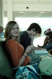 Airport waiting teens Royalty Free Stock Image