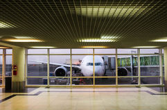 Airport window. Parked aircraft on an airport through the gate window Royalty Free Stock Images