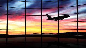 Airport window. With airplane flying at sunset stock photos