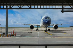 Airport window. Parked aircraft on an airport through the gate window Royalty Free Stock Photos
