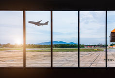 Airport windows and airplane Royalty Free Stock Image